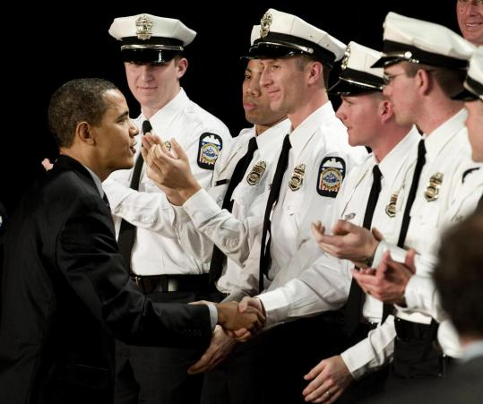 President Obama greeted police officers yesterday at their graduation ceremony in Columbus, Ohio.