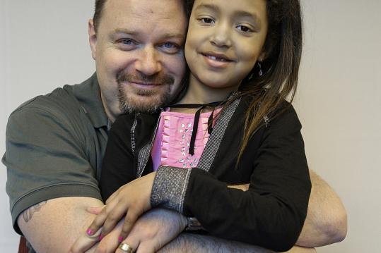 John Dunlop and his 6-year-old daughter, Malaika. Dunlop, a Marblehead native, is home on leave from his deployment in Baghdad with a US Army provincial reconstruction team.