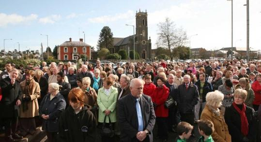 Members of a Catholic congregation prayed yesterday near the Massereene army barracks in Antrim, Northern Ireland, where two British soldiers were shot to death Saturday.