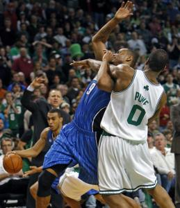 When Leon Powe got whistled for his sixth foul while battling Orlando's Rashard Lewis (top) in the fourth quarter, coach Doc Rivers made clear his displeasure with the call.