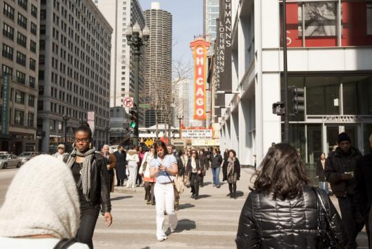 Walkers bustled along downtown Chicago's State Street last week. The area declines while it was a pedestrian mall.