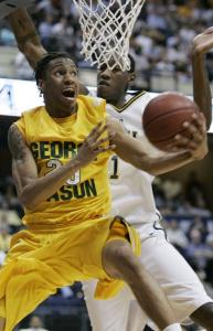 George Mason's Cam Long tries to get a shot around VCU's Larry Sanders, who dominated inside with seven blocks.