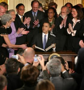 Surrounded by scientists, President Obama ended eight years of strict rules on embryonic stem cell research.