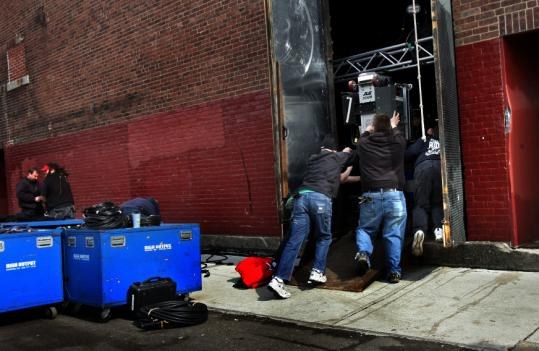 Crews delivered equipment for the not-so-secret U2 concert in Somerville.