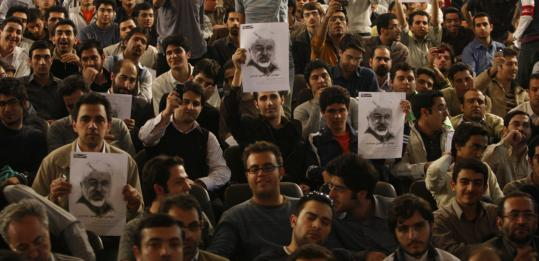 Tehran University students held posters in support of former prime minister Mir Hossein Mousavi, who announced he would run for the presidency to restore faith in public policy.