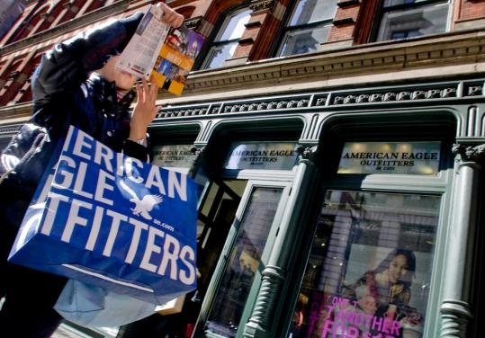 American Eagle Outfitters, which has increasingly focused on value, has struggled with slumping sales. The retailer said yesterday fourth-quarter profit tumbled 77 percent.