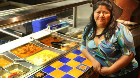 Maria Landaverde, at the Maya Sol Restaurant, has found that food from her native Guatamala is a better choice for her.
