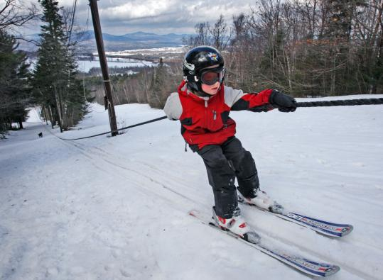 Miles Wharton, 6, zipped uphill on the rope tow this week at the Mount Prospect Ski Tow in Lancaster, N.H.