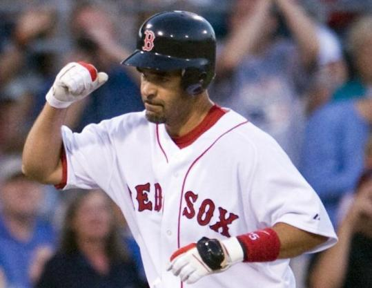 Mike Lowell punctuates his first-inning homer against the Yankees, the highlight of his evening offensively.