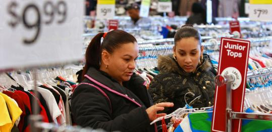 Valerie Lopez (above right) hunts for bargains at A.J. Wright in Fields Corner with her mother, Migdalia Diaz, earlier this month. The store sells a variety of items at a discount, including shoes and clothing for newborn babies.
