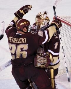 Nick Petrecki is the first to congratulate BC goalie John Muse on his shutout.