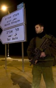 An Israeli soldier stood guard yesterday near the scene of a shooting attack in the West Bank in which two Israeli policemen were killed. No Palestinian group claimed responsibility for the attack, near the border with Jordan.