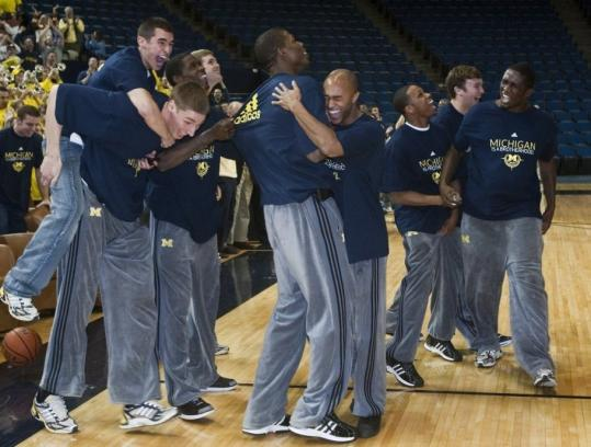Michigan players rejoiced after seeing their team included in the 65-team field. The Wolverines ended an 11-year NCAA Tournament drought.