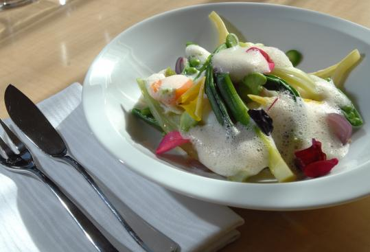 Cod steamed in lemongrass with seasonal vegetables is served over soba in a coconut and grapefruit sauce. It's light and invigorating.