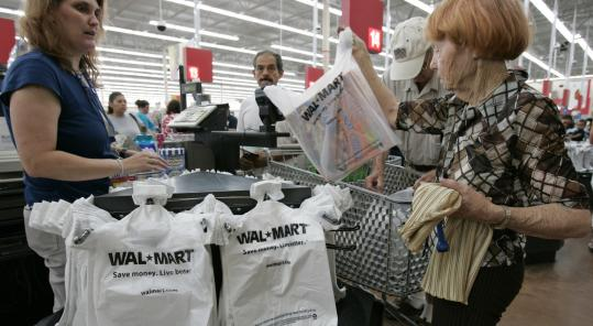 Wal-Mart shoppers are purchasing more store brand items, so the chain is adding nearly 100 products to its lineup.