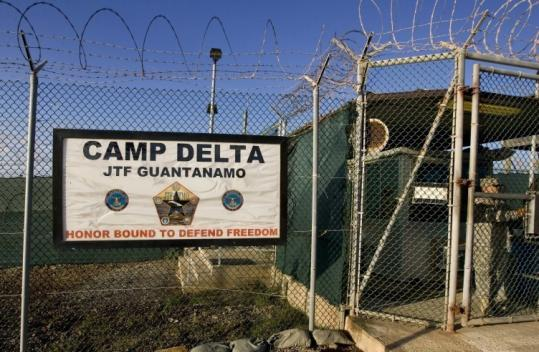 A guard stood at Camp Delta detention compound, which houses foreign prisoners, at Guantanamo Bay US Naval Base.