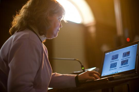 The Rev. Anne Gardner selected a movie clip from her computer during a sermon on forgiveness. An Episcopal priest, Gardner is director of spiritual and religious life at Phillips Academy in Andover.