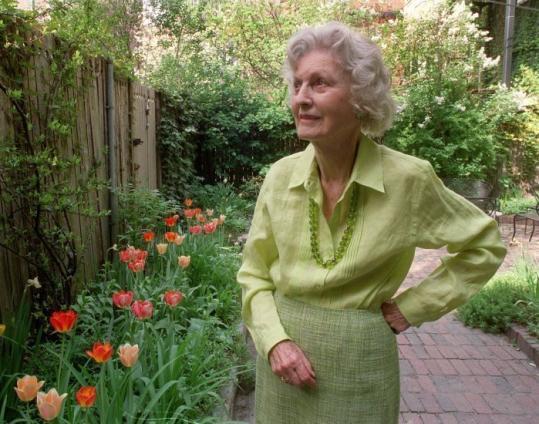 Stella Trafford, seen in her garden, helped sidetrack a plan to erect 600-foot buildings near the Public Garden.
