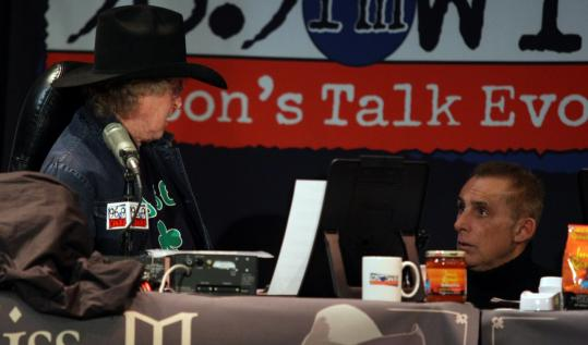 From left: Don Imus rips into Jay Severin at the Wilbur Theatre yesterday; Severin leaves the stage after his confrontation with Imus.