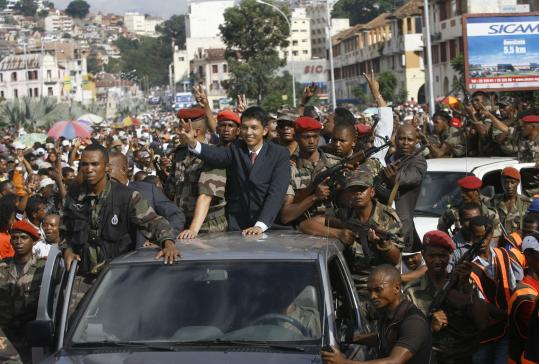 Opposition leader Andry Rajoelina paraded through the Antananarivo, Madagascar, after taking the seat of power yesterday.