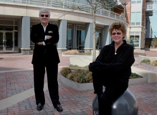 François Nivaud and Susan Wilson in front of the Maritime Museum, which will assemble the history of maritime Boston.