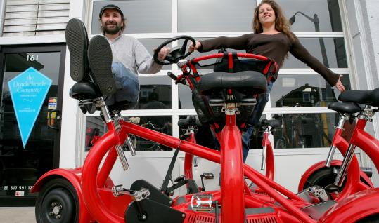 Dan Sorger and Maria Salve, siting atop a conference bike at their new Somerville location, moved from southern Florida to be closer to their customers.