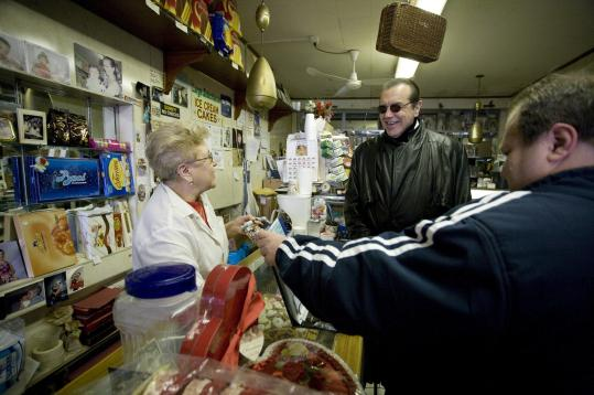 Chazz Palminteri greets old friends Chiara and Jerome, who run Gino's Pastry Shop in the Belmont section of the Bronx where Palminteri grew up.