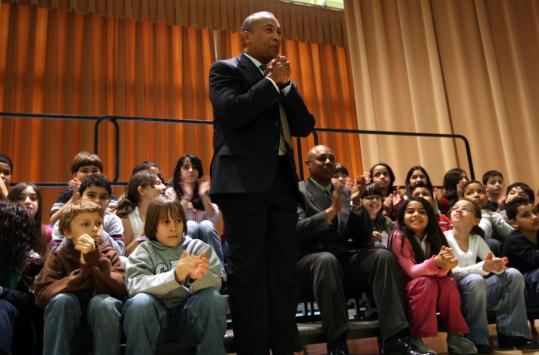 Governor Deval Patrick was welcomed yesterday at Woodrow Wilson Elementary School in Framingham by the principal, Robin Welch (seated to Patrick's left).