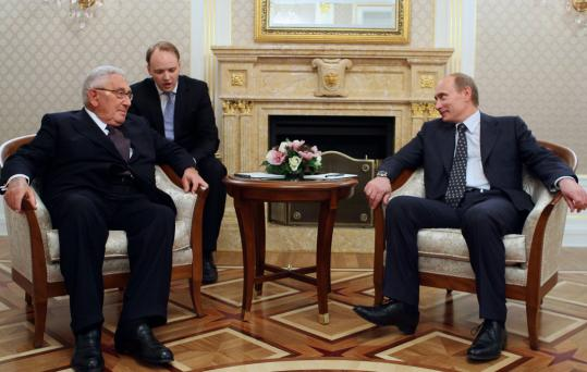 Russia's prime minister, Vladimir Putin (right), listened to a translation last night during a meeting in Moscow with former secretary of state Henry Kissinger.