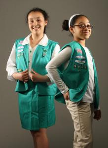 Juliana Quiles (left) and Nia Gaines, both of Hyde Park, modeled old and new Girl Scout uniforms.