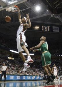 Charlie Villanueva scores for Milwaukee in the March 15 game against Boston.