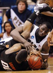 DeJuan Blair (right) hits the deck in battle for a loose ball with Oklahoma State's Byron Eaton.