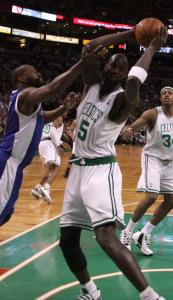 Kevin Garnett takes a rebound away from the Clippers' Baron Davis. Garnett went 5 for 5 from the field in his third game back from a knee injury.