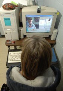 Jackie Spinos, a student at the Burlington Evening Academy, learns from a Guatemalan tutor via Skype.