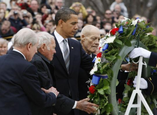 SOLEMN MOMENT - President Obama, accompanied by past recipients of the National Medal of Honor, laid a wreath at the Tomb of the Unknowns at Arlington National Cemetery in Virginia yesterday.