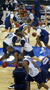 The Wildcats run through a unique dribbling drill in preparation for their game with Duke.
