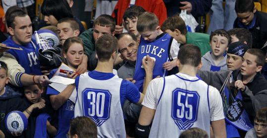 After a practice session yesterday at TD Banknorth Garden, some Duke players signed autographs for young fans.