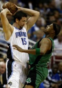 Hedo Turkoglu plays keepaway from Paul Pierce in the first half.