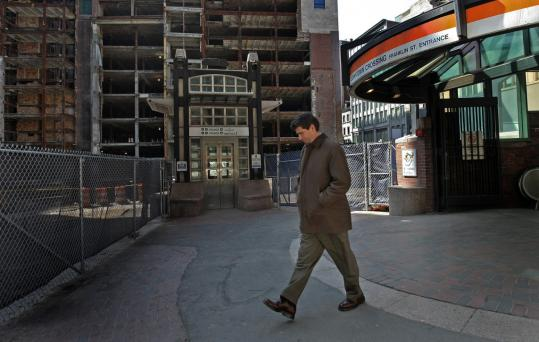 Incomplete construction at the site of the Filene's building at Downtown Crossing has been called a blight on the neighborhood. Don Jones walks by it several times a week while working.