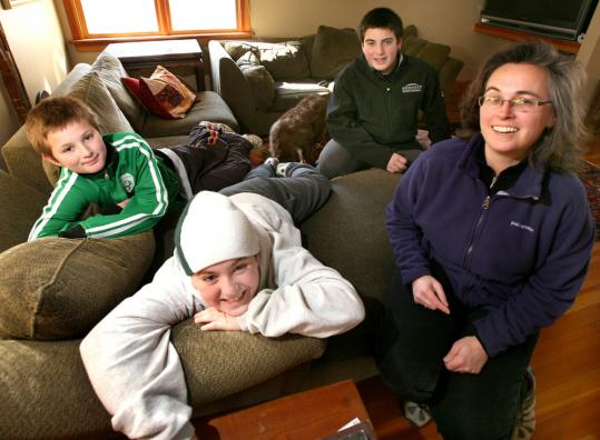 Karen Grey and her husband couldn't afford to send all three children to camp. Hugh, 11, (left) was less eager to go, so he'll stay home when his twin, Bryce, (front) and Owen, 14, are away.