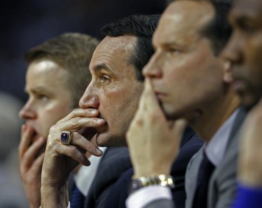 Duke coach Mike Krzyzewski and his assistants could only sit and watch as their Blue Devils were blown out after intermission.