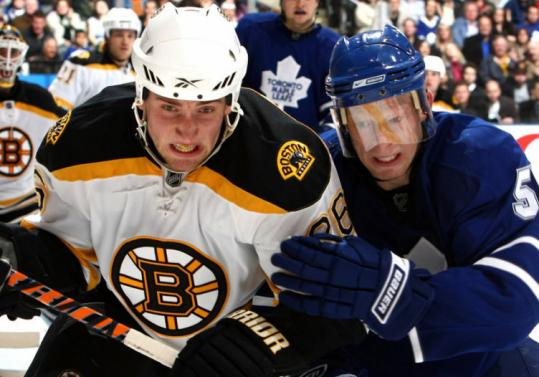 Toronto's Jason Blake had his hands full with Bruin Blake Wheeler, who gave the Bruins a 7-4 lead in the second period.