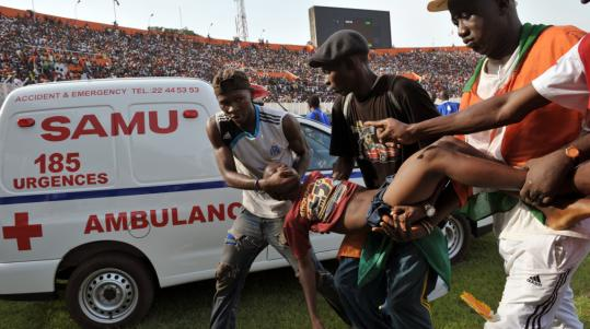 A young fan, one of 132 injured in a stampede before the World Cup qualifying match, was evacuated yesterday from the stadium in the Ivory Coast capital of Abidjan.