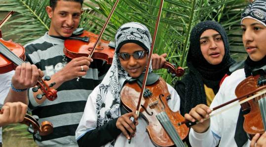 Orchestra members from the Jenin refugee camp in the West Bank posed after playing last week near Tel Aviv. A camp leader said the children had been exploited for political reasons.