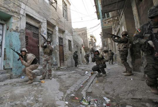 Iraqi soldiers moved through the Sunni neighborhood of Fadhil in Baghdad yesterday in an effort to quell the fighting.