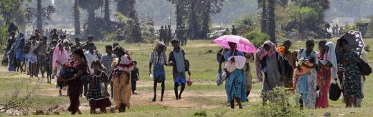 Sri Lankan Tamil civilians arriving at a government-controlled area after fleeing territory controlled by the the Liberation Tigers of Tamil Eelan last week.