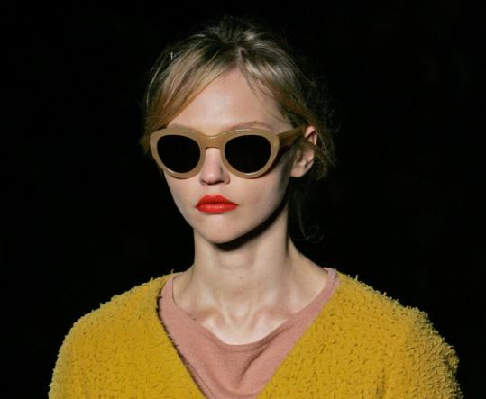 Models for Dries Van Noten painted their lips in citrus shades, from tangerine to blood orange.