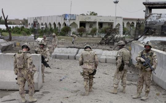 Canadian soldiers with the International Security Assistance Force stood outside the provincial council office after suicide attacks in Kandahar Province, Afghanistan yesterday.