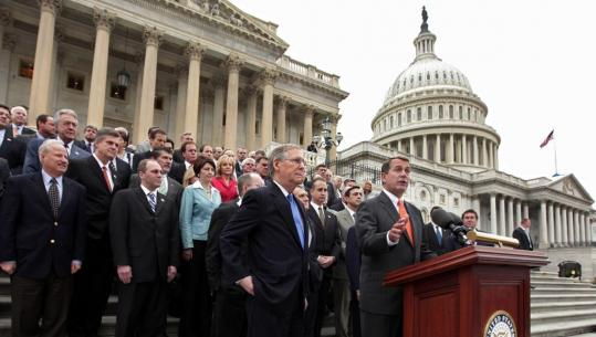 House minority leader John Boehner of Ohio, at podium, with Senate minority leader Mitch McConnell of Kentucky and other Republicans, spoke against the president's budget priorities.