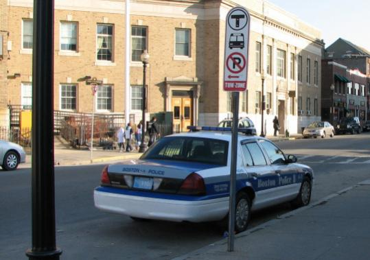 A Boston police cruiser was parked yesterday in a space reserved for MBTA buses